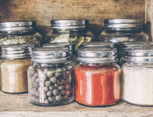 A Professional Home Organizer's Top Tips For Spice Cabinet Organization